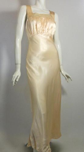 3bd0addda8b0 1940s pale peach satin bias cut nightgown with sheer silk robe trimmed in  ecru lace, buttons at waist. Back of gown has deep V. Faint spot on left  strap.